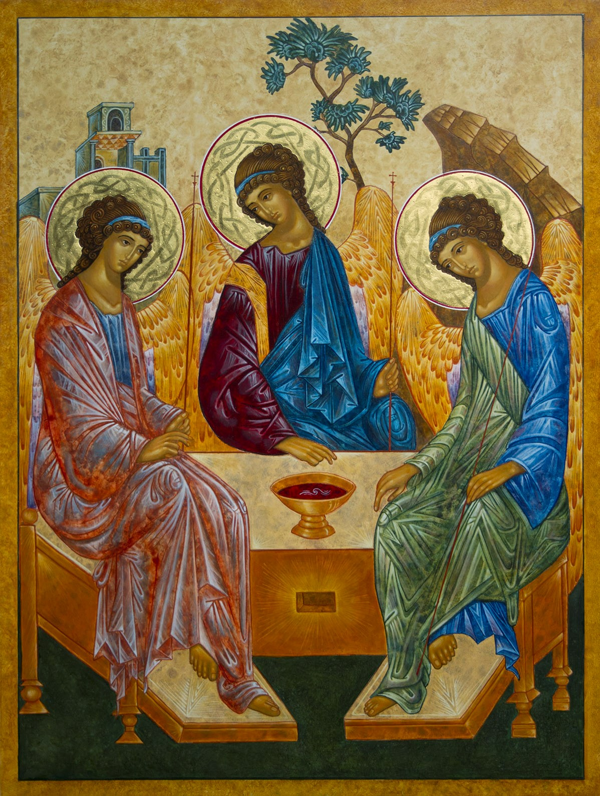 Rublev's classic icon of the trinity as three people sitting at a table.
