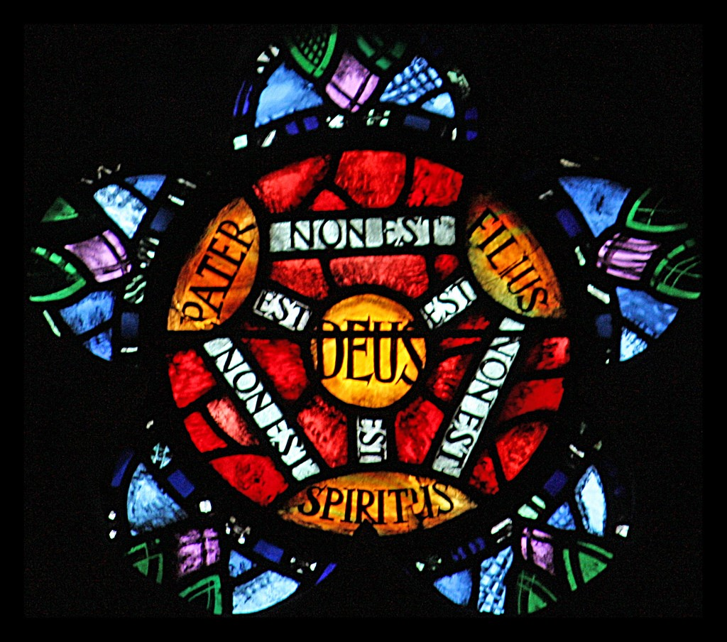 A stained glass window portraying the shield of faith.